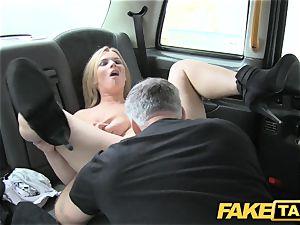 fake cab immense congenital boobs on towheaded model