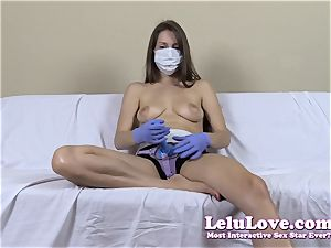 bare-breasted nymph with medical mask and strap on dildo
