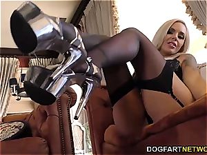 frisky Nina Elle uses her feet and mouth to satiate