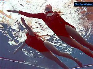 two steaming teens underwater