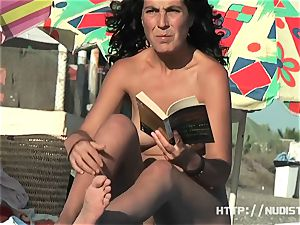 A very adorable doll in a Spanish nudist beach